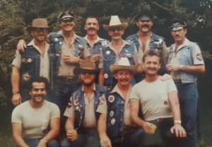 Rangers MC members in Club uniform at the South Pacific Motor Club Comerong Run 1984. Back Row: Rob (surname unknown), Ian Mann, Greg Prentis, Brian Allen, John Muller, Unknown Front Row: Victor Forsella, Victor Cook, Allan Killips, Kevin Vinters